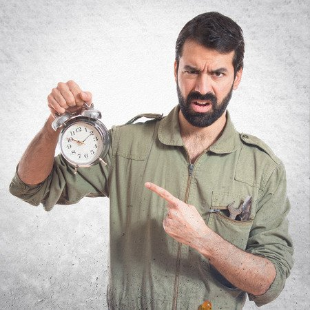 38346335 - mechanic holding vintage clock